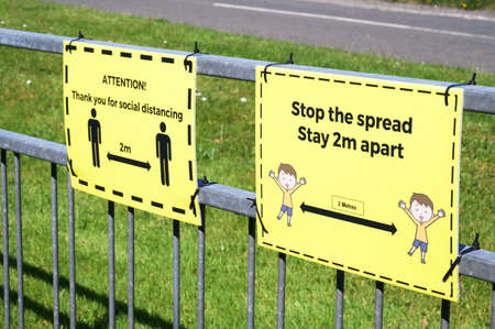 Social distancing sign at school playground road crossing