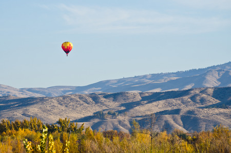 Hot Air Balloon Flying Over The Foothills
