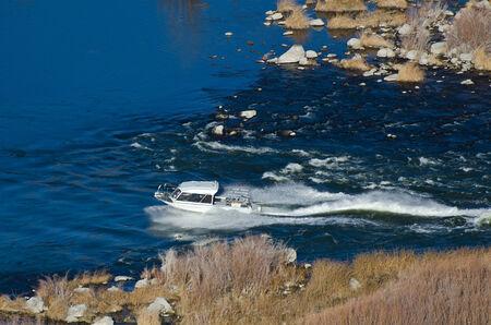 Pleasure Boat Sailing Through Canyon