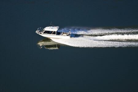 Pleasure Boat Moving Down River