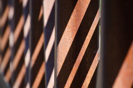 girders: Abstract – Diagonal Shadow Pattern on Rusty Bridge Girders Stock Photo