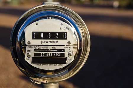 save electricity: Electric Meter Displaying Current Power Consumption Stock Photo
