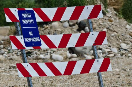 barricade: Blue and White Private Property Sign on Construction Barricade