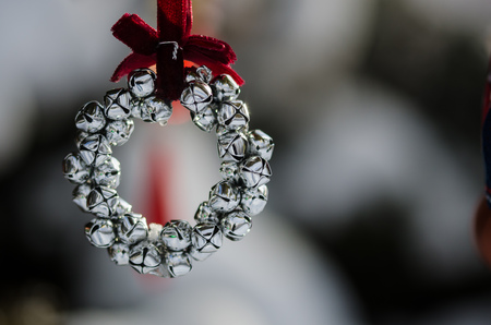 Silver Jingle Bell Wreath Christmas Ornament Decorating an Outdoor Tree