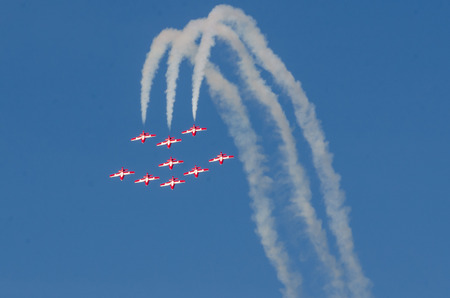 in unison: Boise, Idaho, USA – October 15, 2017.  Canadian Forces Snowbirds performing at the Gowen Thunder airshow on October 15, 2017.