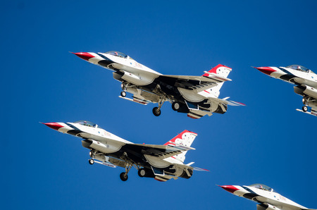 in unison: Boise, Idaho, USA – October 15, 2017.  United States Air Force Thunderbirds performing at the Gowen Thunder airshow on October 15, 2017.