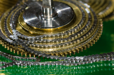 Watch Repair: Vintage Pocket Watch Fusee Chain Coiled Around the Fusee Cone Stock Photo