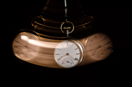 Swinging Pocket Watch Beckoning You to Look More Closely Imagens - 93516160