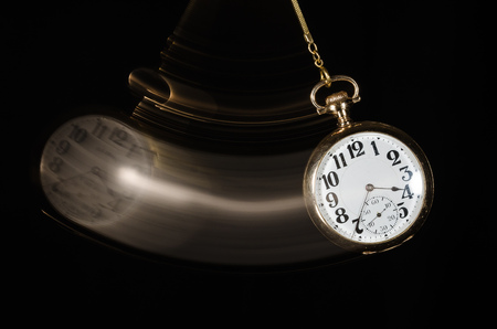 Swinging Pocket Watch Beckoning You to Look More Closely