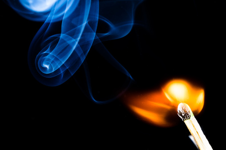 Smoke Swirling from Burnt Wooden Matchstick