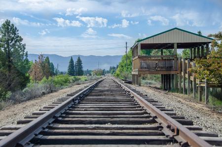 Rural Mountain Railroad Platform Waiting for Train and Passengers