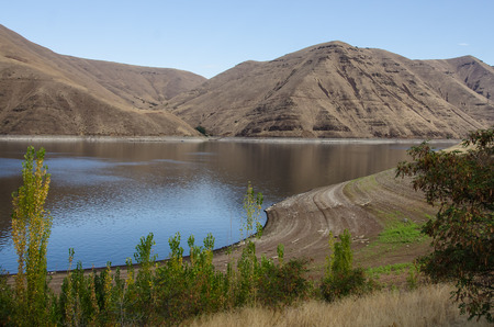 Extreme Drought Conditions as Water Levels Drop in Reservoir Фото со стока