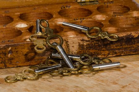 Antique Pocket Watch Keys Scattered on the Watchmaker's Bench Stock Photo