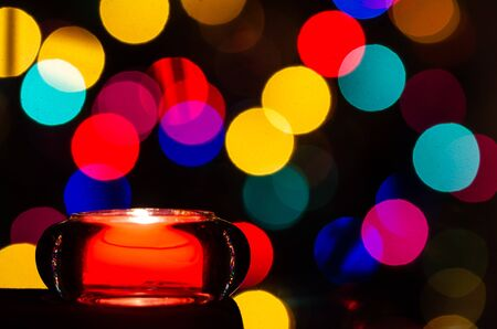 Red Christmas Candle Enveloped in Christmas Lights Stock Photo