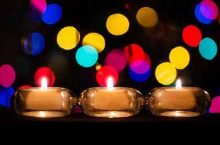 White Christmas Candles Enveloped in Christmas Lights