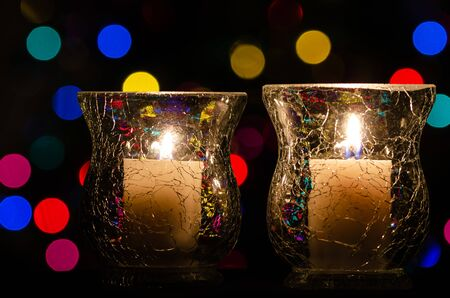 White Christmas Candles Enveloped in Christmas Lights Reklamní fotografie - 126961343