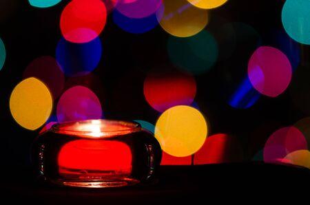 Red Christmas Candle Enveloped in Christmas Lights Reklamní fotografie - 127765005