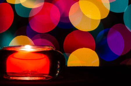 Red Christmas Candle Enveloped in Christmas Lights Reklamní fotografie