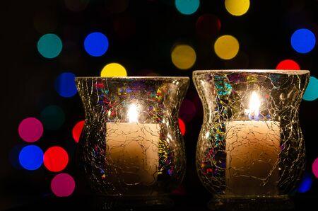 White Christmas Candles Enveloped in Christmas Lights Reklamní fotografie - 127765008
