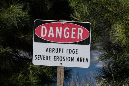 Danger Sign Warning of Erosion and an Abrupt Edge