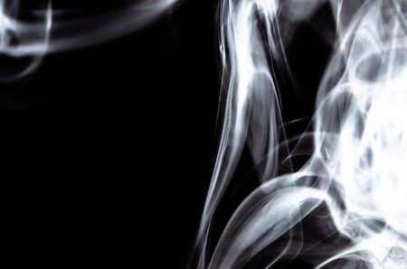 Nature Abstract: The Delicate Beauty and Elegance of a Wisp of White Smoke Stock Photo