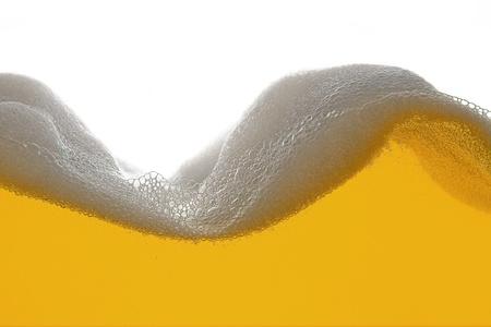 beer bubbles: beer foam wave Stock Photo