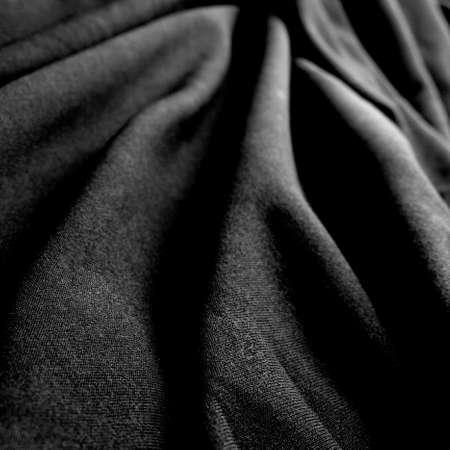 breathable: a wrinkled black silk cloth Stock Photo