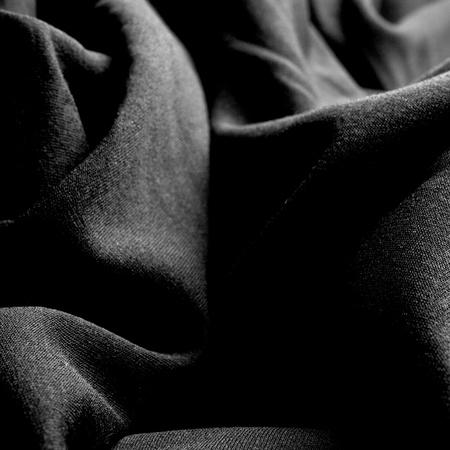tela seda: un paño negro de seda arrugada