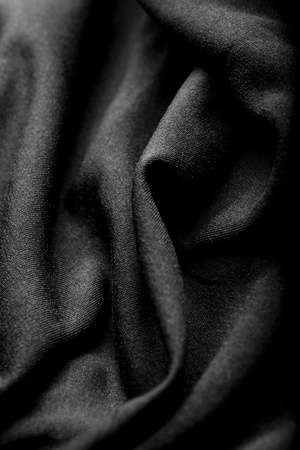 black silk: a wrinkled black silk cloth Stock Photo