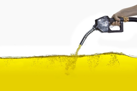 refuel: gasoline nozzle and hand Stock Photo