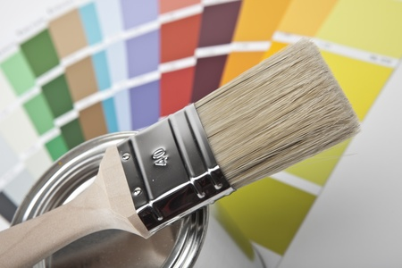 paint buckets with paint brush and color-curricular