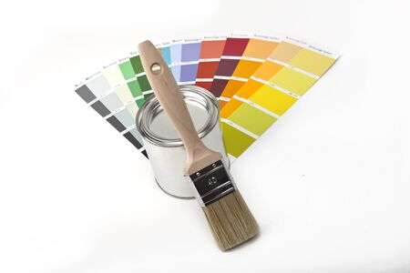 interior designers: paint buckets with paint brush and color-curricular