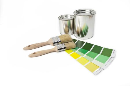 ral: two paint buckets with paint and two color farbf�cher Stock Photo