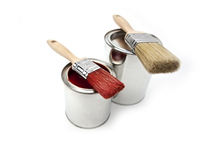 ral: two paint buckets with two-color brush and red paint Stock Photo