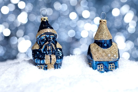 two blue christmas ball on snow with bokeh background photo