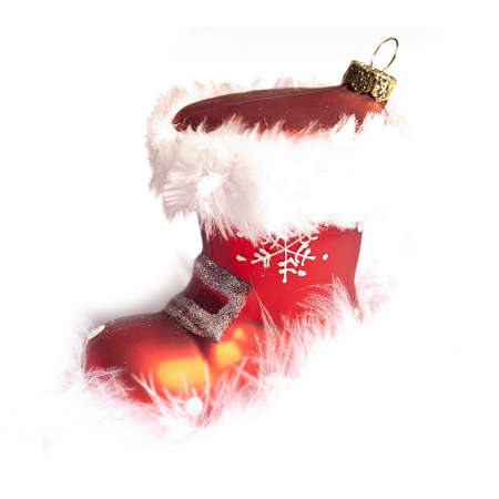 nicholas: a red christmas boots on snow