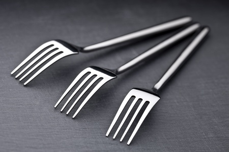 three forks on a slate plate photo