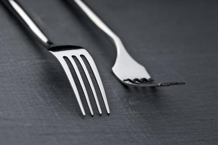 two forks on a slate plate photo