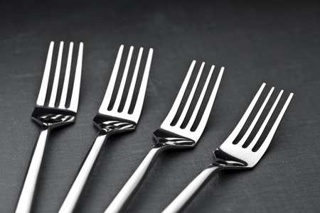 four forks on a slate plate photo