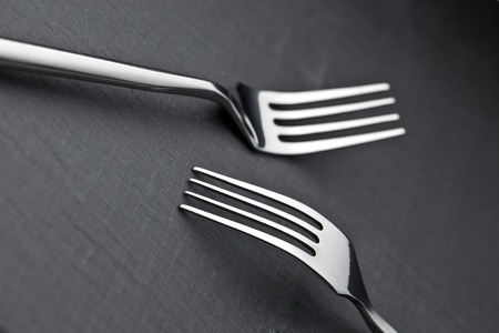 two forks on a slate plate photo