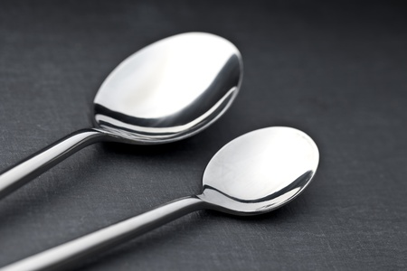 two spoons on a slate plate photo