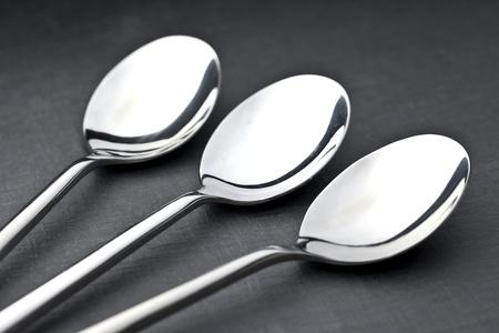 three spoons on a slate plate photo