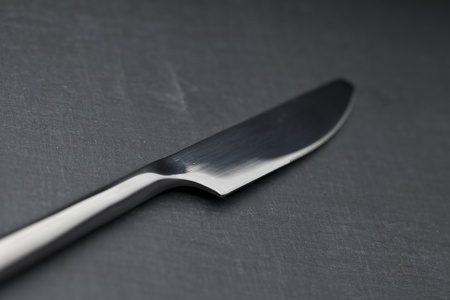 knife on a slate plate photo
