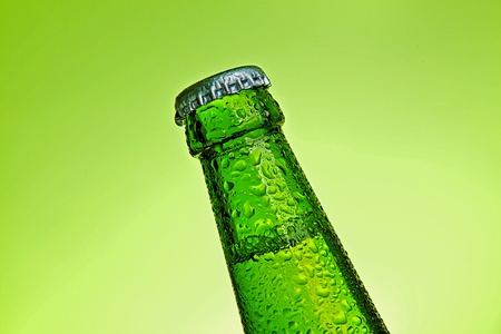 beer bottle with drops photo