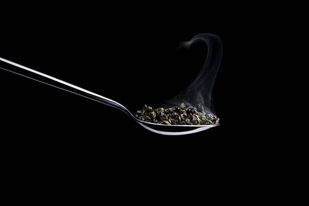 spoon with tea and steam Stock Photo - 11334783