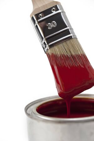 paintbrush with red paint photo