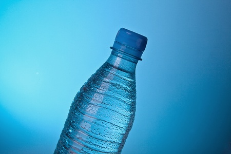 Water bottle in front of blue background photo