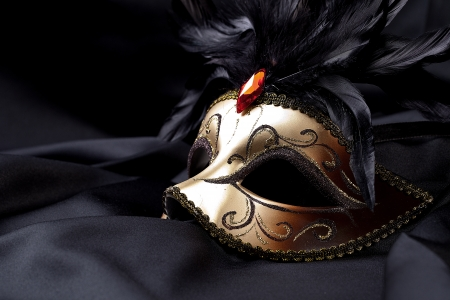 gold mask on black silk photo