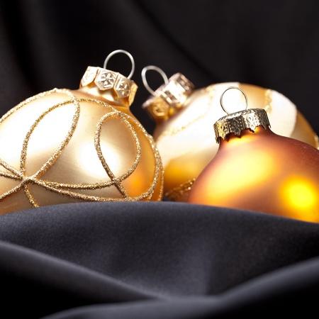 shafts: three golden christmas balls on silk Stock Photo