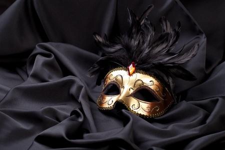 black silk: gold mask on black silk